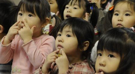 """A group of girls from the Hokuto preschool act out, """"Head, shoulders, knees and toes"""" in Chitose, Japan, Nov. 15, 2010. A dozen Airmen based out of Kadena Air Base paid a visit to the school during their temporary duty. Nearly 200 Airmen are at Chitose Air Base, Japan as part of an Aviation Training Location designed to enhance bilateral relations between Japan and the U.S. (U.S. Air Force photo by Tech. Sgt. Mike Tateishi)"""