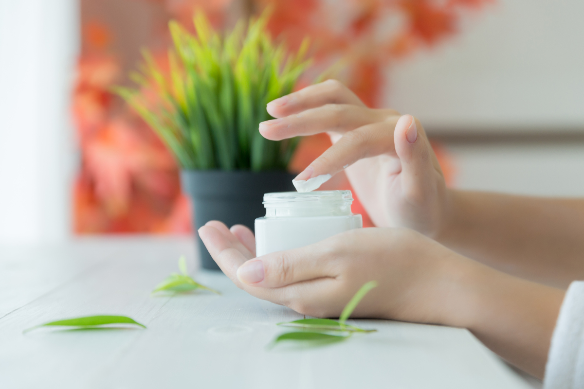 woman holds a jar with a cosmetic cream in her hands. skin care