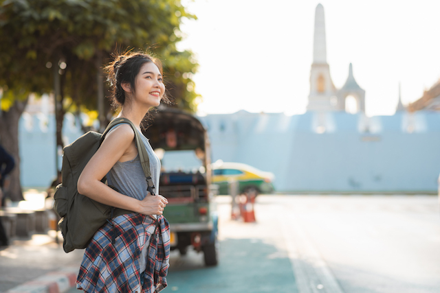 traveler asian woman traveling and walking in bangkok, thailand, backpacker female feeling happy spending relax time in holiday trip. lifestyle women travel in asia city concept.