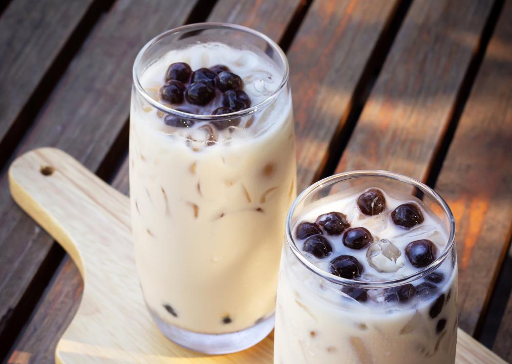 bubble milk tea in glass. trendy beverage in asia. sweet drink w