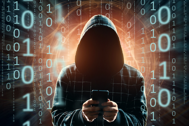 a young hacker in a hood hacks a smartphone, a hacker attack, a silhouette of a man, mixed media. the concept of a sudden attack, cryptography, data security, mobile internet.
