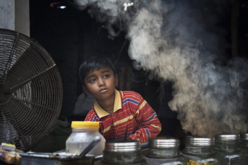 Young street vendor with smoke, Varanasi Benares India