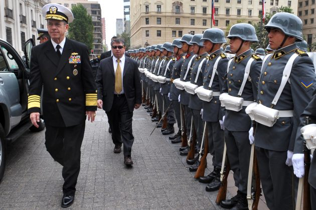 Chairman of the Joint Chiefs of Staff U.S. Navy Adm. Mike Mullen walks past a formation of Chilean troops in Santiago, Chile, March 3, 2009. The chairman visited the country to meet with senior Chilean officials and speak at the Chilean Army War College. DoD photo by Air Force Master Sgt. Adam M. Stump. (Released)