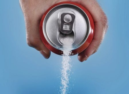 pouring-sugar-out-of-soda-can